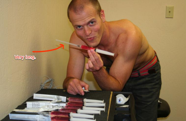 tim holding syringe